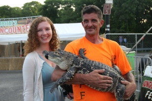 One of our Summer 2015 interns Tara with a gator handler at the 2015 Brookhaven Town Fair.