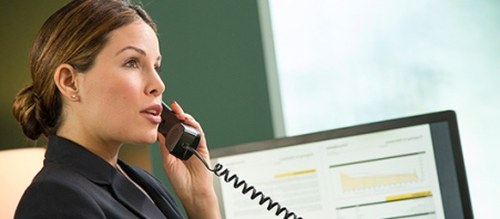 A financial advisor speaks to a client on the phone.