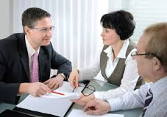 A financial advisor consults with clients.