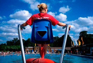 A lifeguard watching over a pool.